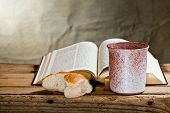stock photo of chalice  - still life with Bible chalice and bread - JPG