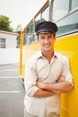 picture of bus driver  - Smiling bus driver looking at camera outside the elementary school - JPG