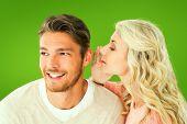 Attractive blonde whispering secret to boyfriend against green vignette