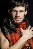 portrait of handsome man warmed up in scarf christmas colored, s