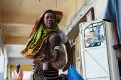 Black African Mother With A Baby In A Sling.