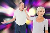 Older couple having an argument against twinkling yellow and purple lights