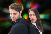 Unhappy couple not speaking to each other against blurred lights