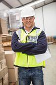 foto of hard_hat  - Portrait of worker wearing hard hat in the warehouse - JPG