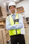 Portrait of worker wearing hard hat in the warehouse