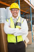 image of hard-on  - Portrait of manager wearing hard hat in the warehouse - JPG