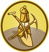 Mining or miner's lamp with shovel and pick axe