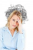 Woman with headache against tangled lines over light bulb
