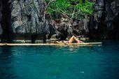 Beautiful Woman Relaxing On Raft In Tropical Lagoon