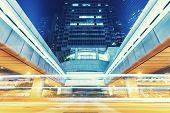 traffic light trails in modern city at night