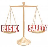 Risk Vs Safety 3d words on a gold scale to illustrate, weigh or compare the differences between two options and their relative danger or warning factors