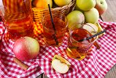 stock photo of cider apples  - still life with apple cider and fresh apples - JPG