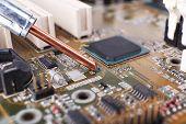 image of rework  - Repairing of computer motherboard - JPG