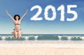 Excited Woman On Beach With Numbers 2015