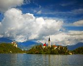 St Martin church on island and Bled lake landscape with mountain