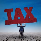 Manager Holding A Sign Of Tax
