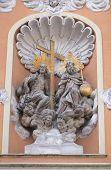 GRAZ, AUSTRIA - JANUARY 10, 2015: Holy Trinity on the portal of Dreifaltigkeitskirche ( Holy Trinity ) church in Graz, Styria, Austria on January 10, 2015.