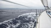 Sailing in the sea during deteriorating weather (cloudy weather). Cruise luxury yacht. Journey on the Sailboat.