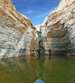 Clean cold water in the creek canyon. Sandstone walls apart, like butterfly wings. Picturesque canyon En-Avdat in the Negev desert