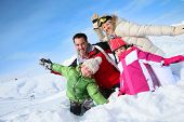 Cheerful family having good time in snowy mountain