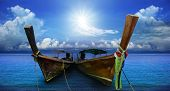 Thai Andaman Long Tailed Boat Southern Of Thailand On Sea Beach With Beautiful Sun Shining Over Sky