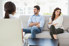 picture of irritated  - Psychologist helping a couple with relationship difficulties in the office - JPG