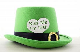 picture of irish  - Happy St Patricks Day green leprechaun hat on white wood table with Kiss Me I am Irish heart shape greeting sign - JPG