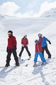 image of family ski vacation  - Family On Ski Holiday In Mountains - JPG