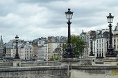 picture of lamp post  - A row of traditional Parisian rooftops with lamp posts - JPG