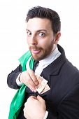 stock photo of sarcasm  - Businessman hiding Brazilian money and the flag of Brazil - JPG