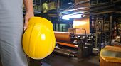 image of workplace safety  - Worker with safety helmet at industrial factory - JPG