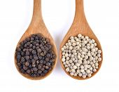 stock photo of peppercorns  - Wooden spoon and black peppercorn on white background - JPG