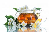 image of teapot  - jasmine tea in a teapot with a branch of jasmine on white background - JPG
