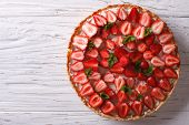 picture of tarts  - Delicious tart with fresh strawberries and soft cheese on the table - JPG