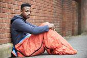 picture of runaway  - Vulnerable Teenage Boy Sleeping On The Street - JPG