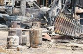 stock photo of petroleum  - Burnt liquid petroleum gas cylinders in fire situation - JPG