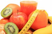 stock photo of immune  - Fresh ripe natural fruits glass of juice and tape measure concept for slimming healthy nutrition and strengthening immunity - JPG