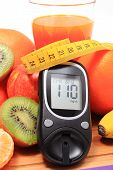 picture of immune  - Glucometer fresh ripe natural fruits with tape measure and glass of juice on cutting board concept for diabetes healthy nutrition and strengthening immunity - JPG