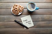 pic of monday  - Cup of coffee with fresh cookies and Happy Monday massage on wooden table - JPG