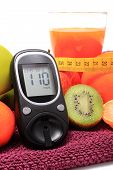 picture of immune  - Glucometer fresh fruits with tape measure and glass of juice concept for diabetes slimming healthy nutrition and strengthening immunity - JPG