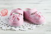 stock photo of pink shoes  - Pink toddler shoes on wooden background - JPG