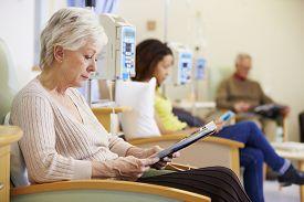 stock photo of chemotherapy  - Senior Woman Undergoing Chemotherapy In Hospital - JPG
