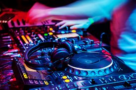 stock photo of disc jockey  - Dj mixes the track in the nightclub at party - JPG