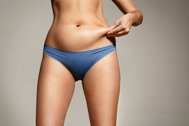 picture of body shapes  - woman pinched her fat on body - JPG