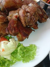 picture of pork belly  - baked pork belly with garlic at restaurant - JPG