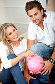 Couple saving money in a piggy bank