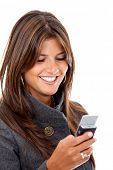 stock photo of mobile-phone  - business woman sending a text message on her mobile phone  - JPG