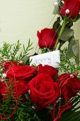 image of saying sorry  - Bouquet of red roses with hand written card saying  - JPG