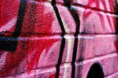Graffiti image on brick wall