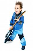 Shot of a little boy playing rock music with electric guitar. Isolated over white background.